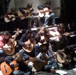 The acoustic guitar ensemble rehearses.